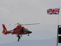 hh-65 dolphin - us marine rescue helicopter with british flag