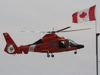 view--hh-65 dolphin - us marine rescue helicopter with canadian flag