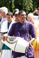 man playing white drum