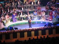 andre rieu inviting the audiences to sing with him