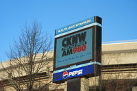 cknw ad in front of deflated bc place
