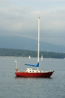 little red boat in english bay