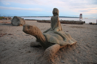 girl on sea turtle