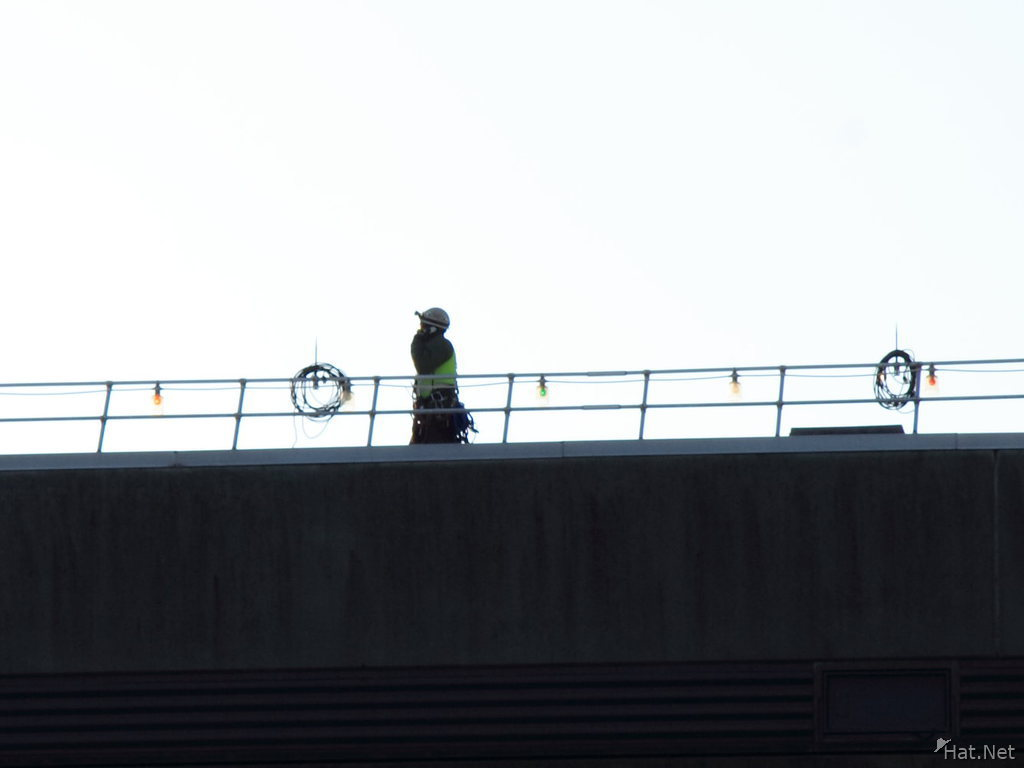 worker trying to fix the roof of bc place