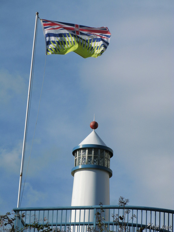bc flag and the light house