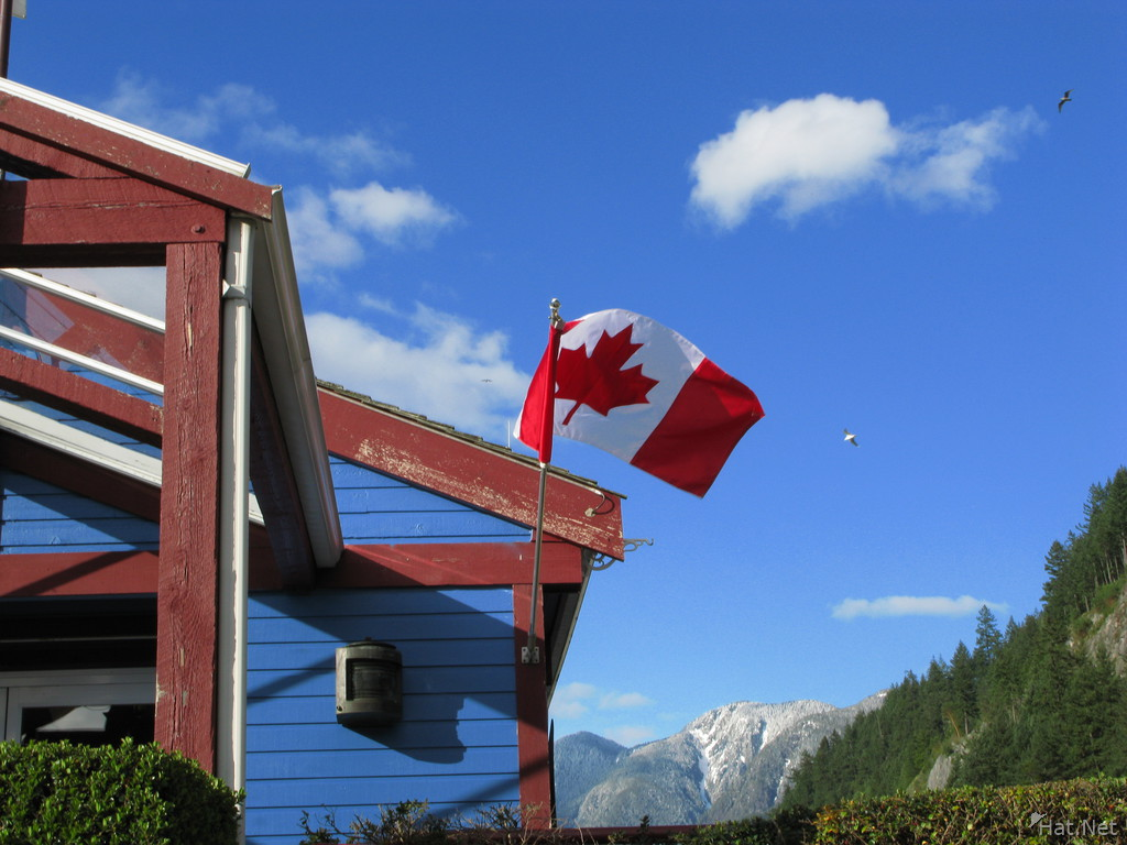 canadian flag on blue coffee house
